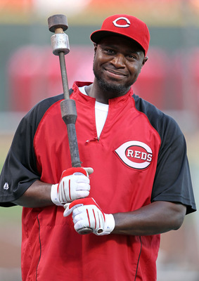 CINCINNATI - OCTOBER 10:  Brandon Phillips #4 of the Cincinnati Reds participates in batting practice before the start of  Game 3 of the NLDS against the Philadelphia Phillies  at Great American Ball Park on October 10, 2010 in Cincinnati, Ohio.  (Photo b