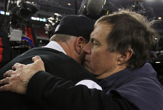 FOXBORO, MA - JANUARY 16:  Head coach Rex Ryan of the New York Jets hugs head coach Bill Belichick of the New England Patriots after the Jets defeated the Patriots 28 to 21 in their 2011 AFC divisional playoff game at Gillette Stadium on January 16, 2011