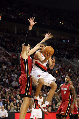 PORTLAND, OR - JANUARY 09: Nicolas Batum #88 of the Portland Trail Blazers goes to the basket against Zydrunas Ilgauskas #11 of the Miami Heat during a game on January 9, 2011 at the Rose Garden Arena in Portland, Oregon. NOTE TO USER: User expressly ackn