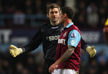 LONDON, ENGLAND - JANUARY 15: Goalkeeper Rob Green of West Ham United talks to Wayne Bridge during the Barclays Premier League match between West Ham United and Arsenal at the Boleyn Ground on January 15, 2011 in London, England.  (Photo by Clive Rose/Get