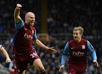 BIRMINGHAM, ENGLAND - JANUARY 16:  James Collins of Aston Villa jumps for joy as he celebrates the equalising goal during the Barclays Premier League match between Birmingham City and Aston Villa at St Andrews on January 16, 2011 in Birmingham, England.
