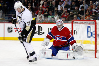 MONTREAL, CANADA - JANUARY 12:  Carey Price #31 of the Montreal Canadiens gets down to stop the puck deflected by Evgeni Malkin #71 of the Pittsburgh Penguins during the NHL game at the Bell Centre on January 12, 2011 in Montreal, Quebec, Canada.  (Photo