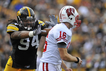 IOWA CITY, IA - OCTOBER 23: Defensive lineman Adrian Clayborn #94 of the University of Iowa Hawkeyes puts pressure on quarterback Scott Tolzien #16 of the Wisconsin Badgers during the first half of play at Kinnick Stadium on October 23, 2010 in Iowa City,