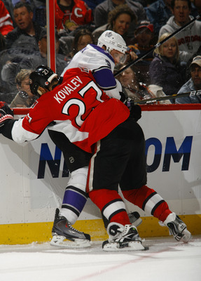 OTTAWA, ON - NOVEMBER 22:  Alex Kovalev #27 of the Ottawa Senators battles along the far boards for the puck with Jack Johnson #3 of the Los Angeles Kings during a game at Scotiabank Place on November 22, 2010 in Ottawa, Ontario, Canada.  (Photo by Philli