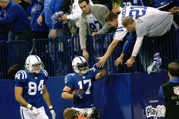 INDIANAPOLIS, IN - DECEMBER 19: Austin Collie #17 of the Indianapolis Colts celebrates with fans after scoring a touchdown as Jacob Tamme #84 looks on against the Jacksonville Jaguars at Lucas Oil Stadium on December 19, 2010 in Indianapolis, Indiana.  (P