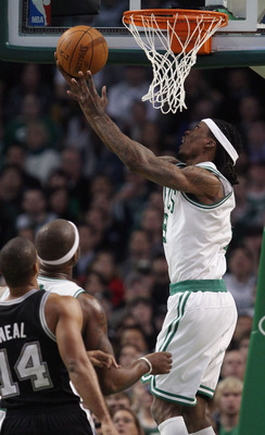 BOSTON, MA - JANUARY 05:  Marquis Daniels #8 of the Boston Celtics takes a shot as Gary Neal #14 of the San Antonio Spurs defends on January 5, 2011 at the TD Garden in Boston, Massachusetts. The Celtics defeated the Spurs 105-103. NOTE TO USER: User expr
