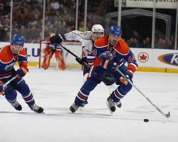 EDMONTON, CANADA - DECEMBER 17:  Sheldon Souray #44 and Sam Gagner #89  of the Edmonton Oilers break up ice against the Nashville Predators on December 17, 2009 at Rexall Place in Edmonton, Alberta, Canada. (Photo by Dale MacMillan/Getty Images)