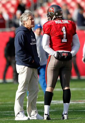 TAMPA, FL - DECEMBER 26:  Head coach Pete Carroll of the Seattle Seahawks talks with punter Robert Malone, #1 of the Tampa Bay Buccaneers just prior to the start of the game against the Tampa Bay Buccaneers at Raymond James Stadium on December 26, 2010 in