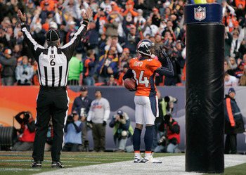 DENVER - NOVEMBER 14:  Wide receiver Brandon Lloyd #84 of the Denver Broncos celebrates 6-yard touchdown reception against the Kansas City Chiefs during the first quarter at INVESCO Field at Mile High on November 14, 2010 in Denver, Colorado. The Denver B