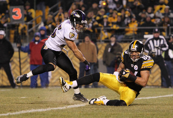 PITTSBURGH, PA - JANUARY 15:  Wide receiver Hines Ward #86 of the Pittsburgh Steelers catches the ball for a touchdown against the Baltimore Ravens in the third quarter of the AFC Divisional Playoff Game at Heinz Field on January 15, 2011 in Pittsburgh, P