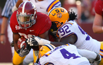TUSCALOOSA, AL - NOVEMBER 07:  Mark Ingram #22 of the Alabama Crimson Tide is tackled by Drake Nevis #92 and Jai Eugene #4 of the Louisiana State University Tigers at Bryant-Denny Stadium on November 7, 2009 in Tuscaloosa, Alabama.  (Photo by Kevin C. Cox