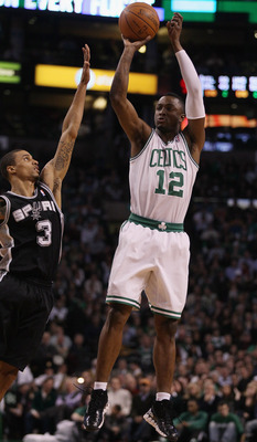 BOSTON, MA - JANUARY 05:  Von Wafer #12 of the Boston Celtics takes a shot as George Hill #3 of the San Antonio Spurs defends on January 5, 2011 at the TD Garden in Boston, Massachusetts. NOTE TO USER: User expressly acknowledges and agrees that, by downl