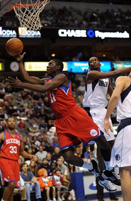 DALLAS - NOVEMBER 30:  Guard Jrue Holiday #11 of the Philadelphia 76ers on November 30, 2009 at American Airlines Center in Dallas, Texas.  NOTE TO USER: User expressly acknowledges and agrees that, by downloading and/or using this Photograph, user is con