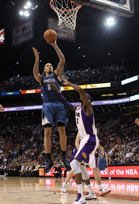 PHOENIX - DECEMBER 15:  Michael Beasley #8 of the Minnesota Timberwolves puts up a shot against the Phoenix Suns during the NBA game at US Airways Center on December 15, 2010 in Phoenix, Arizona. NOTE TO USER: User expressly acknowledges and agrees that,