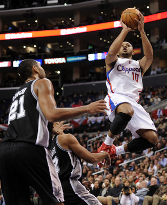 LOS ANGELES, CA - DECEMBER 01:  Eric Gordon #10 of the Los Angeles Clippers shoots a jumper over Tim Duncan #21 of the San Antonio Spurs at the Staples Center on December 1, 2010 in Los Angeles, California.  NOTE TO USER: User expressly acknowledges and a