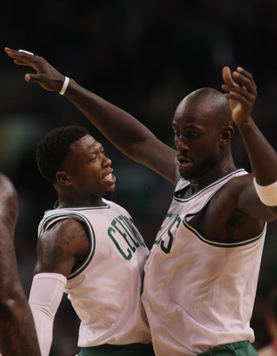 BOSTON - NOVEMBER 24:  Nate Robinson #4 and Kevin Garnett #5 of the Boston Celtics celebrate Garnett's shot in the fourth quarter against the New Jersey Nets on November 24, 2010 at the TD Garden in Boston, Massachusetts. The Celtics defeated the nets 89-