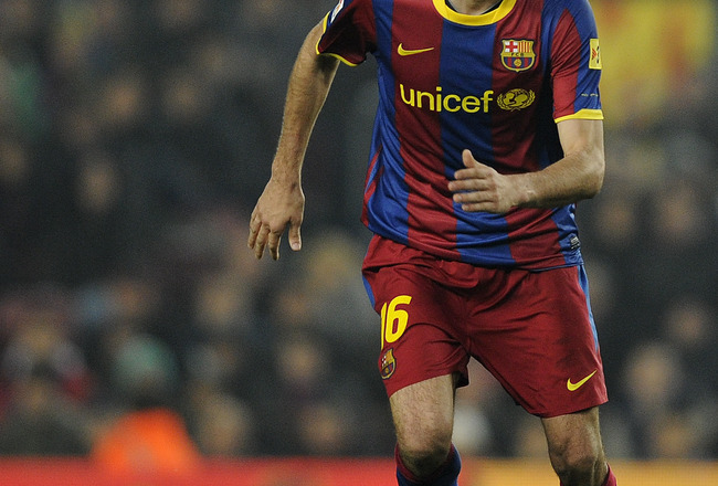 BARCELONA, SPAIN - JANUARY 16:  Sergio Busquets of FC Barcelona runs with the ball during the La Liga match between FC Barcelona and Malaga at Nou Camp on January 16, 2011 in Barcelona, Spain. Barcelona won 4-1.  (Photo by David Ramos/Getty Images)