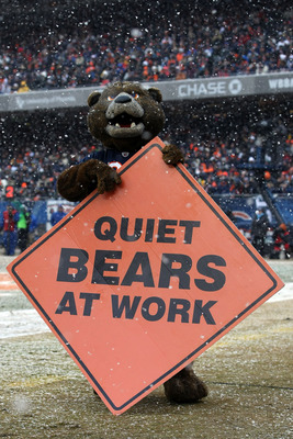 CHICAGO, IL - JANUARY 16:  The Chicago Bears holds a sign on the field in the first half against the Seattle Seahawks in the 2011 NFC divisional playoff game at Soldier Field on January 16, 2011 in Chicago, Illinois.  (Photo by Doug Pensinger/Getty Images