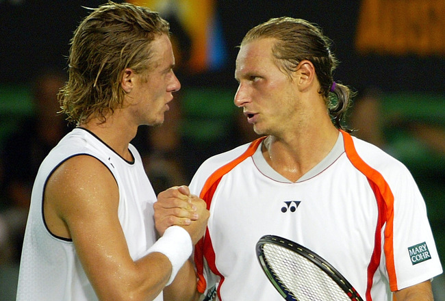 MELBOURNE, AUSTRALIA - JANUARY 26: Lleyton Hewitt of Australia is congratulated by David Nalbandian of Argentina after winning their match during day ten of the Australian Open Grand Slam at Melbourne Park January 26, 2005 in Melbourne, Australia. (Photo
