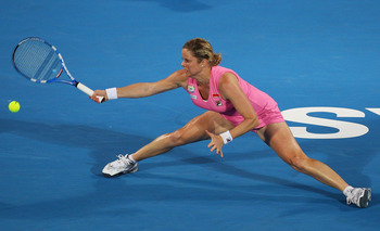 SYDNEY, AUSTRALIA - JANUARY 14:  Kim Clijsters of Belgium stretches to play a forehand in the women's final against Na Li of China during day six of the 2011 Medibank International at Sydney Olympic Park Tennis Centre on January 14, 2011 in Sydney, Austra