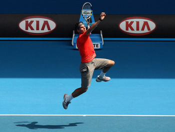 MELBOURNE, AUSTRALIA - JANUARY 16:  Rafael Nadal of Spain leaps for a smash during the 'Rally For Relief' charity exhibition match ahead of the 2011 Australian Open at Melbourne Park on January 16, 2011 in Melbourne, Australia.  (Photo by Mark Dadswell/Ge