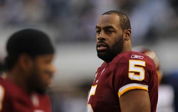 ARLINGTON, TX - DECEMBER 19:  Quarterback Donovan McNabb #5  of the Washington Redskins on the sidelines against play against the Dallas Cowboys at Cowboys Stadium on December 19, 2010 in Arlington, Texas.  (Photo by Ronald Martinez/Getty Images)