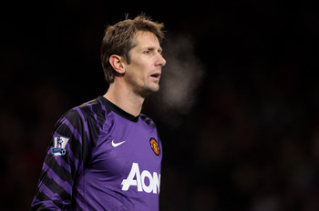 MANCHESTER, ENGLAND - DECEMBER 13:  Edwin van der Sar of Manchester United  looks on during the Barclays Premier League match between Manchester United and Arsenal at Old Trafford on December 13, 2010 in Manchester, England.  (Photo by Alex Livesey/Getty