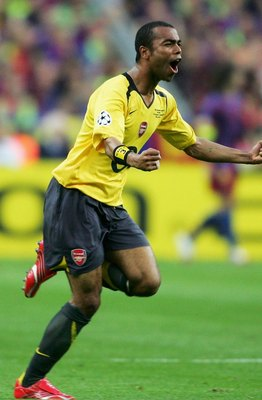 PARIS - MAY 17:  Ashley Cole of Arsenal celebrates as his side score the first goal during the UEFA Champions League Final between Arsenal and Barcelona at the Stade de France on May 17, 2006 in Paris, France.  (Photo by Shaun Botterill/Getty Images)