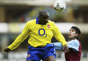 BIRMINGHAM, ENGLAND - JANUARY 18:  Juan Pablo Angel of Aston Villa and Sol Campbell  jump for ball during the FA Barclaycard Premiership match between Aston Villa and Arsenal at Villa Park on January 18, 2004 in Birmingham, England.  (Photo by Shaun Botte
