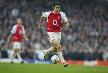 LONDON - MARCH 28:  Robert Pires of Arsenal during the FA Barclaycard Premiership match between Arsenal and Manchester United at Highbury on March 28, 2004 in London.  (Photo by Clive Mason/Getty Images)