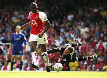 LONDON - MAY 15:  Patrick Vieira of Arsenal scores their second goal during the FA Barclaycard Premiership match between Arsenal and Leicester City at Highbury on May 15, 2004 in London.  (Photo by Clive Mason/Getty Images)