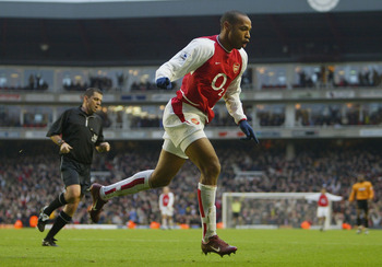 LONDON - DECEMBER 26:  Thierry Henry of Arsenal celebrates scoring his second goal during the FA Barclaycard Premiership match between Arsenal and Wolverhampton Wanderers at Highbury on December 26, 2003 in London.  (Photo by Clive Mason/Getty Images)