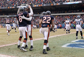 CHICAGO, IL - JANUARY 16:  Quarterback Jay Cutler #6 of the Chicago Bears celebrates with teammate Greg Olsen #82 after Cutler scores on a nine-yard touchdown run in the third quarter against the Seattle Seahawks in the 2011 NFC divisional playoff game at