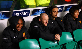 GLASGOW, UNITED KINGDOM - NOVEMBER 05:  (L-R) Anderson, Wayne Rooney, Dimitar Berbatov and Ji-Sung Park of Manchester United sit on the bench during the UEFA Champions League Group E match between Celtic and Manchester United at Parkhead on November 5, 20