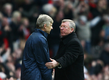 MANCHESTER, UNITED KINGDOM - APRIL 13:  Sir Alex Ferguson, manager of Manchester United consoles Arsene Wenger, manager of Arsenal after the Barclays Premier League match between Manchester United and Arsenal at Old Trafford on April 13, 2008 in Mancheste