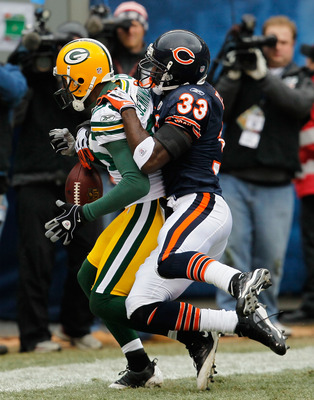 CHICAGO - DECEMBER 13: Greg Jennings #85 of the Green Bay Packers drops the ball in the end zone under pressure from Charles Tillman #33 of the Chicago Bears at Soldier Field on December 13, 2009 in Chicago, Illinois. The Packers defeated the Bears 21-14.
