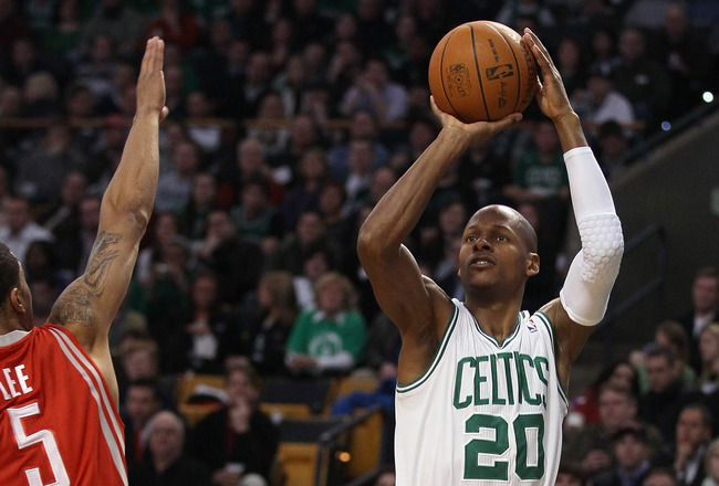 BOSTON, MA - JANUARY 10:  Ray Allen #30 of the Boston Celtics shoots a three point shot as Courtney Lee #5 of the Houston Rockets defends on January 10, 2011 at the TD Garden in Boston, Massachusetts.  NOTE TO USER: User expressly acknowledges and agrees