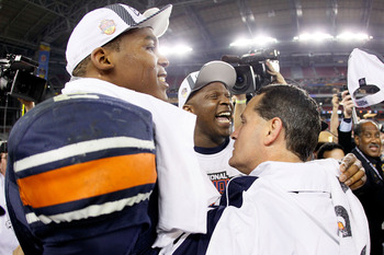 GLENDALE, AZ - JANUARY 10:  Quarterback Cameron Newton #2 and head coach Gene Chizik of the Auburn Tigers celebrate the Tigers 22-19 victory with the fans after defeating the Oregon Ducks in the Tostitos BCS National Championship Game at University of Pho