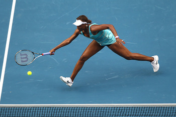 MELBOURNE, AUSTRALIA - JANUARY 17:  Venus Williams of the United States of America plays a forehand in her first round match against Sara Errani of Italy during day one of the 2011 Australian Open at Melbourne Park on January 17, 2011 in Melbourne, Austra