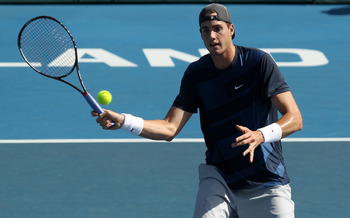 AUCKLAND, NEW ZEALAND - JANUARY 13:  John Isner of the USA plays a forehand during his match against David Nalbandian of Argentina on day four of the Heineken Open at the ASB Tennis Centre on January 13, 2011 in Auckland, New Zealand.  (Photo by Phil Walt