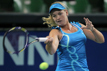 TOKYO - SEPTEMBER 30:  Coco Vandeweghe of the United States plays a forehand in her match against Victoria Azarenka of Belarus on day five of the Toray Pan Pacific Open tennis tournament at Ariake Colosseum on September 30, 2010 in Tokyo, Japan.  (Photo b
