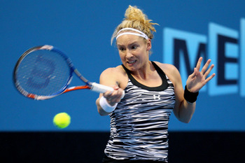 MELBOURNE, AUSTRALIA - JANUARY 17:  Bethanie Mattek-Sands of the USA plays a backhand in her first round match against  Arantxa Rus of The Netherlands during day one of the 2011 Australian Open at Melbourne Park on January 17, 2011 in Melbourne, Australia