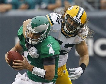 Kevin Kolb is lucky that Clay Matthews didn't take his head off on this play.