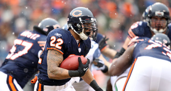 CHICAGO, IL - JANUARY 16:  Running back Matt Forte #22 of the Chicago Bears runs the ball in the first half against the Seattle Seahawks in the 2011 NFC divisional playoff game at Soldier Field on January 16, 2011 in Chicago, Illinois.  (Photo by Andy Lyo