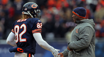 CHICAGO, IL - JANUARY 16:  Tight end Greg Olsen #82 of the Chicago Bears celebrates a third quarter touchdown by Jay Cutler #6 with head coach Lovie Smith against the Seattle Seahawks in the 2011 NFC divisional playoff game at Soldier Field on January 16,