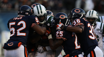 CHICAGO, IL - DECEMBER 26: Joe McKnight #25 of the New York Jets is tackled by Brian Iwuh #52, Rashied Davis #81, Garrett Wolfe #25 and Josh Bullocks #36 of the Chicago Bears at Soldier Field on December 26, 2010 in Chicago, Illinois. The Bears defeated t