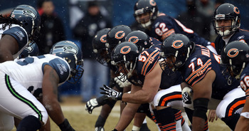 CHICAGO, IL - JANUARY 16:  Center Olin Kreutz #57 of the Chicago Bears prepares to snap the ball against the Seattle Seahawks in the first half in the 2011 NFC divisional playoff game at Soldier Field on January 16, 2011 in Chicago, Illinois.  (Photo by J