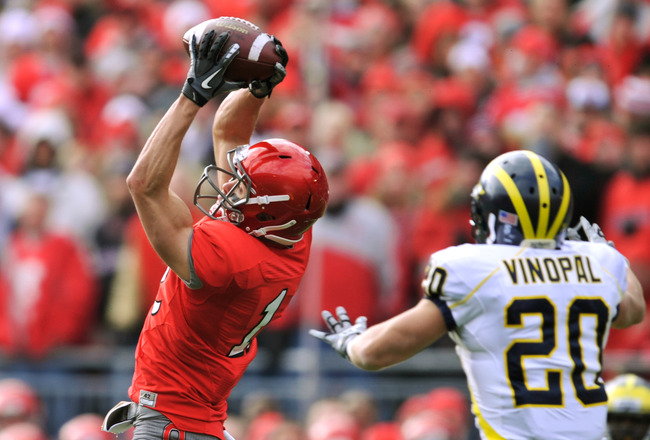 COLUMBUS, OH - NOVEMBER 27:  Dane Sanzenbacher #12 of the Ohio State Buckeyes catches a pass for a first down in front of Ray Vinopal #20 of the Michigan Wolverines at Ohio Stadium on November 27, 2010 in Columbus, Ohio.  (Photo by Jamie Sabau/Getty Image