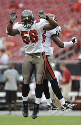 TAMPA, FL - AUGUST 23: Linebacker Quincy Black #58 of the Tampa Bay Buccaneers practices a celebration jump during warmups against the Jacksonville Jaguars at Raymond James Stadium on August 23, 2008 in Tampa, Florida.   (Photo by Al Messerschmidt/Getty I