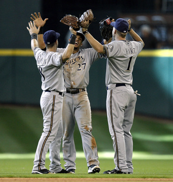 HOUSTON - SEPTEMBER 15:  Carlos Gomez, center, Ryan Braun, left, and Corey Hart of the Milwaukee Brewers celebrate their win over the Houston Astros 8-6 in ten innings at Minute Maid Park on September 15, 2010 in Houston, Texas.  (Photo by Bob Levey/Getty